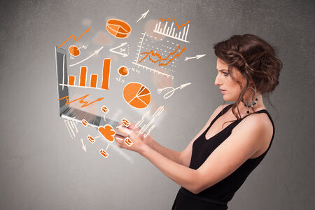 Beautiful young lady holding laptop with graphs and statistics photo