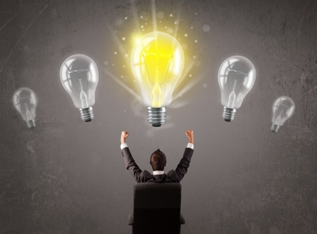 idea light bulb: Business person having an bright idea light bulb concept Stock Photo