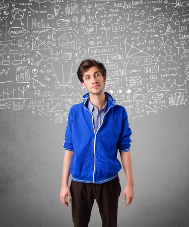 Young handsome guy with hand drawn white calculations and icons