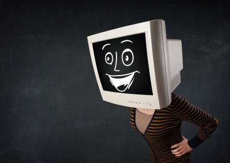 Girl with a monitor screen face and a happy cartoon face photo