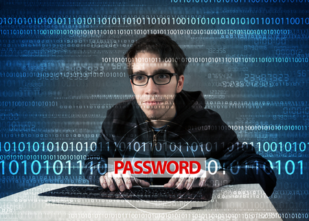 Young geek hacker stealing password on futuristic  photo