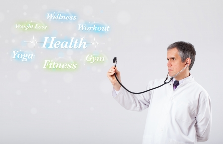 proffesional: Elderly clinical doctor pointing to health and fitness collection of words