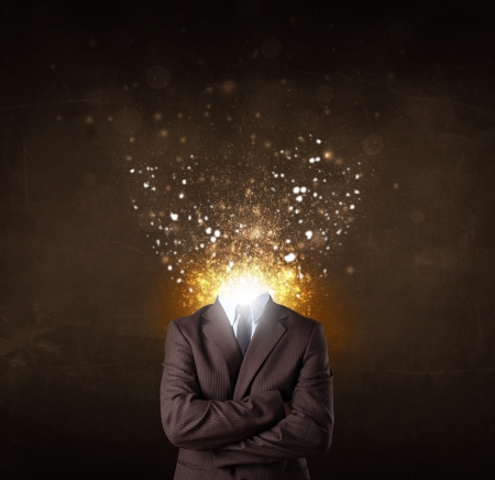 Business man with glowing exploding head concept Stock Photo