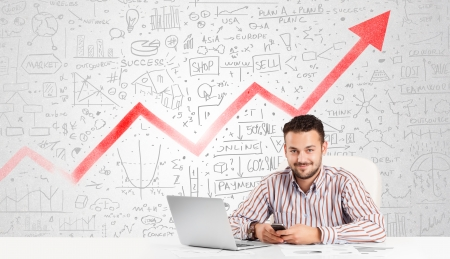 Business man sitting at table with market hand drawn diagrams Stock Photo - 25330168