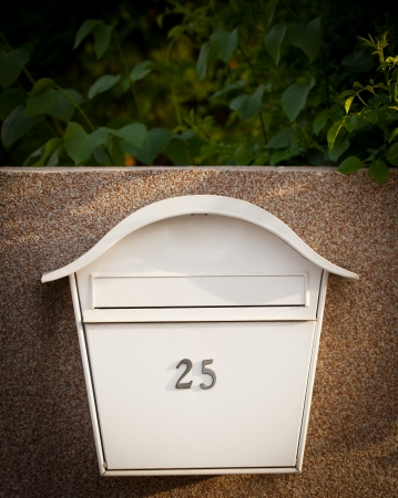Cloes up of a mailbox on the street with fence Stock Photo