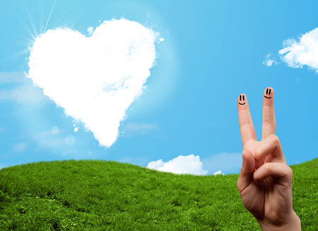 Happy cheerful smiley fingers looking at heart shaped cloud Stock Photo