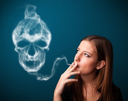 Pretty young woman smoking dangerous cigarette with toxic skull smoke Stock Photo - 25526809
