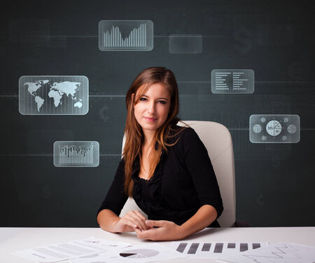 Businesswoman doing paperwork with futuristic digital backgroung photo
