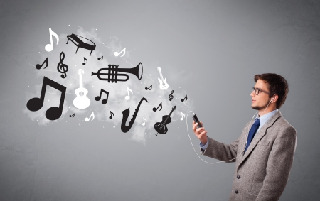 attractive young man singing and listening to music with musical notes and instruments getting out of his mouth photo