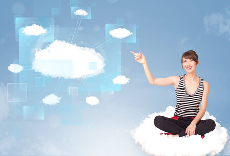 Happy young girl looking at modern cloud network photo