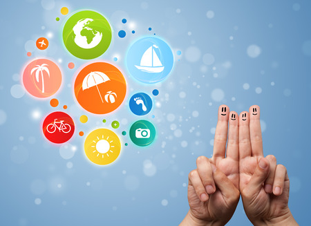 Cheerful happy smiling fingers with colorful holiday travel bubble icons photo