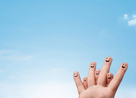 Happy cheerful smiley fingers looking at clear blue sky copyspace photo