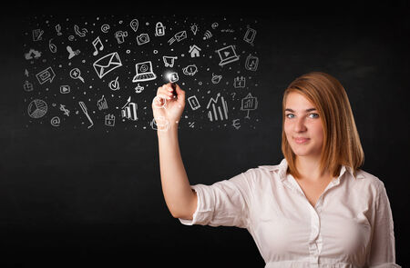 Young woman drawing and sketching icons and symbols on white background photo