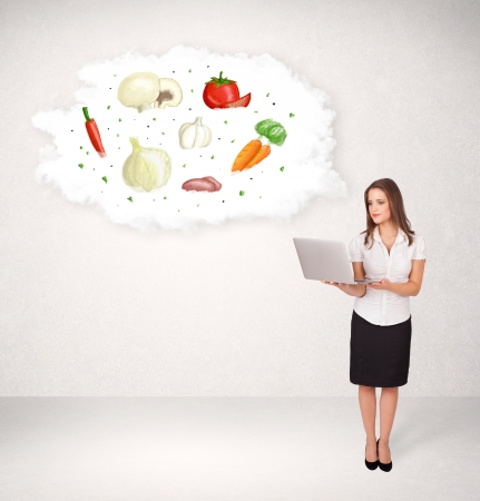 nutritional: Young girl presenting nutritional cloud with vegetables concept Stock Photo