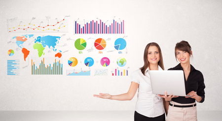 Business woman with colorful graphs and charts concepts photo