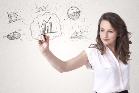 Young lady sketching financial chart icons and symbols on white background photo