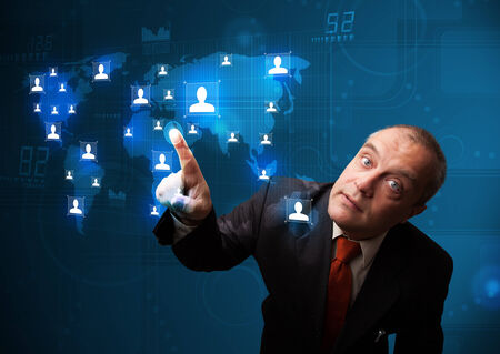 Businessman standing and choosing from social network map photo