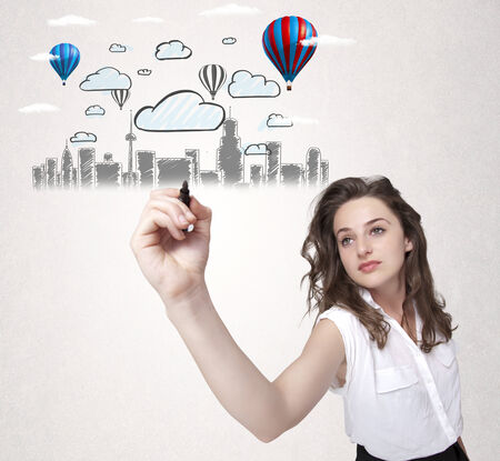Pretty woman sketching cityscape with colorful balloons and clouds photo