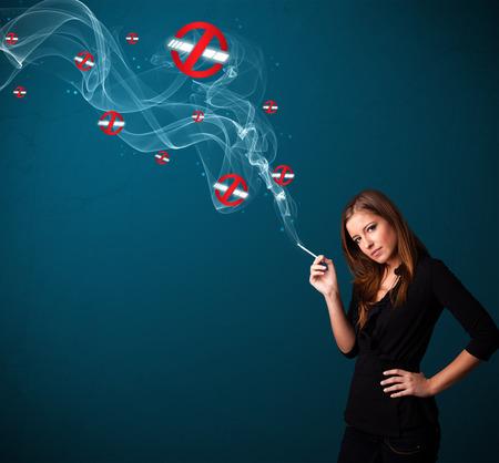 Beautiful young woman smoking dangerous cigarette with no smoking signs Stock Photo - 25687844