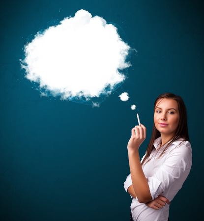 Pretty young woman smoking unhealthy cigarette with dense smoke photo