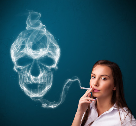 Pretty young woman smoking dangerous cigarette with toxic skull smoke  photo