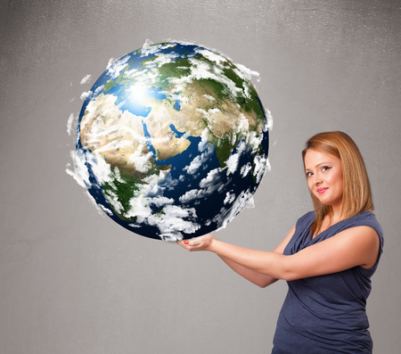 Pretty young girl holding 3d planet earth photo
