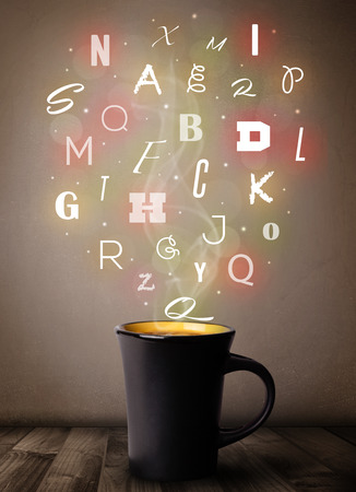 Coffee cup with colorful letters, close up photo