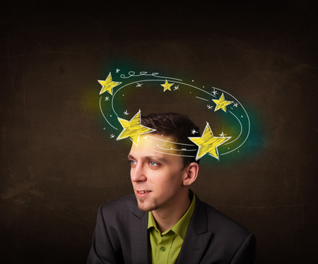 Young man with yellow stars circleing around his head illustration