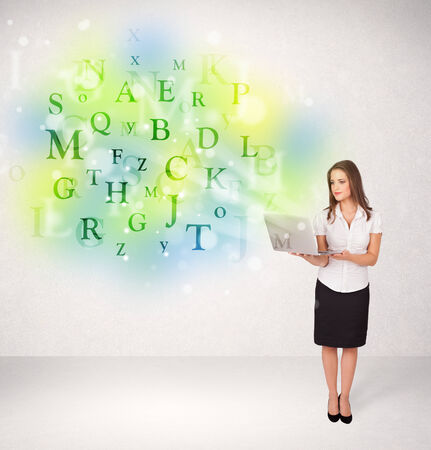 Business women with green glowing letter concept photo