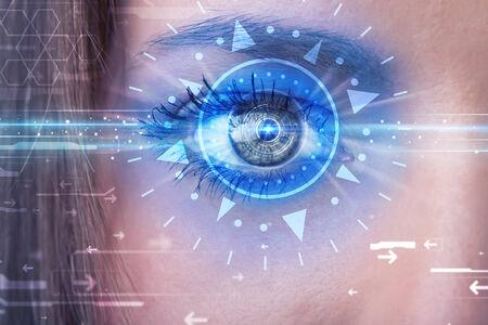 cyber girl: Modern cyber girl with technolgy eye looking into blue iris