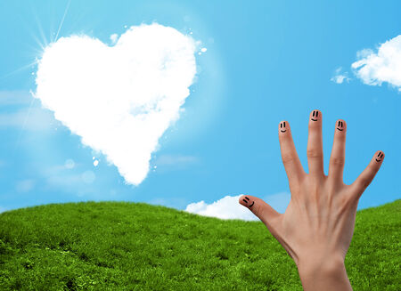 Happy cheerful smiley fingers looking at heart shaped cloud photo
