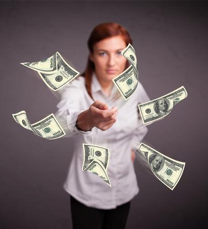Beautiful young girl throwing money Stock Photo - 25911176