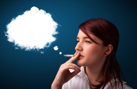 steam mouth: Pretty young woman smoking unhealthy cigarette with dense smoke