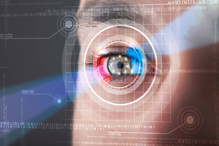 Modern cyber man with technolgy eye looking photo