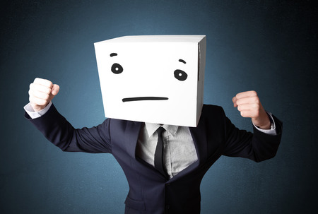 boxy: Businessman standing and gesturing with a cardboard box on his head with straight face