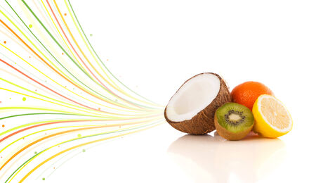 Healthy tropical fruits with colorful abstract lines on white  photo