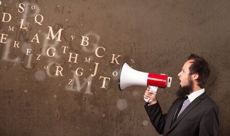single word: Man in shirt shouting into megaphone and abstract text come out