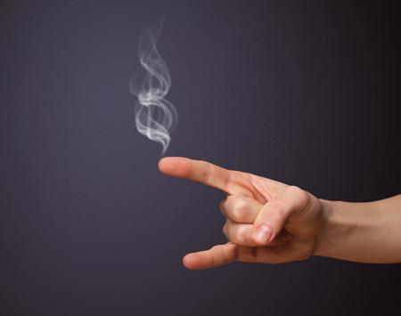 Gun shaped man hand with smoke Stock Photo