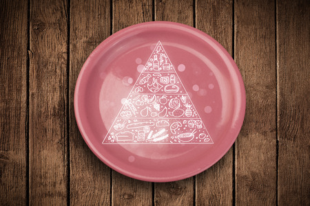 Hand drawn food pyramid on colorful dish plate and grungy table  photo