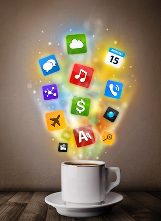 Coffee mug with colorful media icons, close up photo