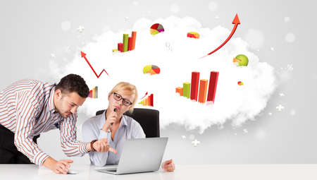 Young businessman and businesswoman with cloud in the containing colorful graphs and diagrams photo