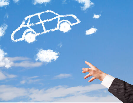 Hand pointing towards at a car cloud on a blue sky photo
