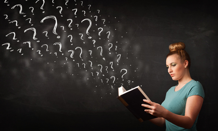 Confused woman reading a book with question marks coming out from it photo