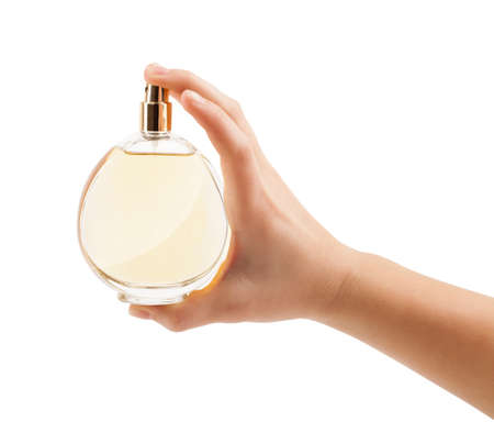 close up of woman hands spraying perfume photo