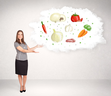 peasant woman: Young girl presenting nutritional cloud with vegetables concept Stock Photo