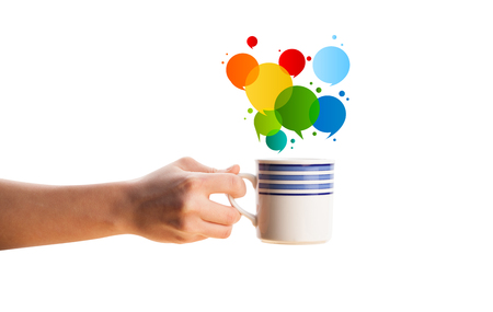 Coffee-mug with colorful abstract speech bubble, isolated on white photo