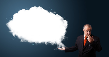 funny businessman in suit holding a phone and presenting abstract cloud copy space photo