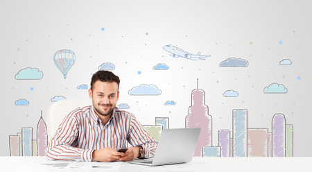 Attractive young businessman with city sky-scape background photo