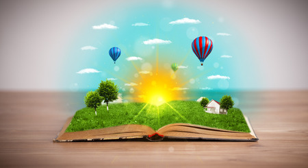 Open book with green nature world coming out of its pages, ecological concept photo
