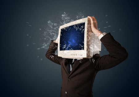 Computer monitor screen exploding on a young persons head concept photo